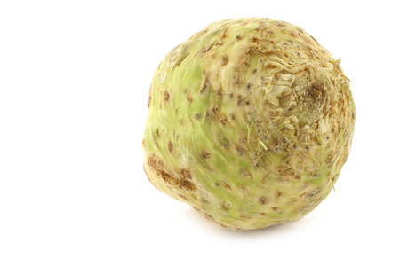 apium graveolens: fresh celery root (Apium graveolens var. rapaceum) on a white background