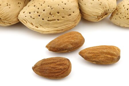 un healthy: almond nuts on a white background Stock Photo