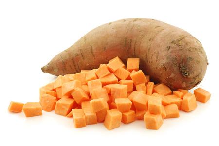 one whole sweet potato and cut blocks on a white background Standard-Bild