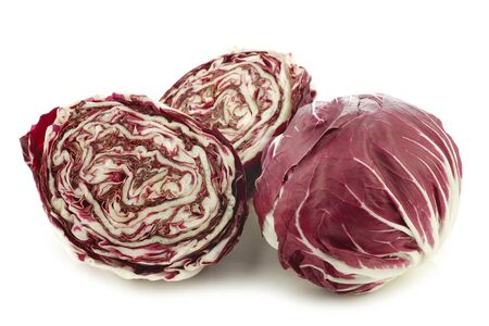 radicchio: red radicchio lettuce and two halves on a white background