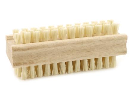 nail brush: wooden nail brush on a white background