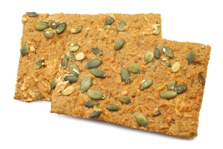 spelled: crispy spelled crackers with pumpkin seeds and cheese on a white background Stock Photo
