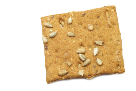 spelled: crispy spelled cracker with sunflower seeds on a white background
