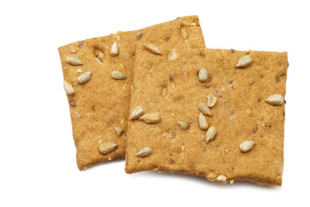 spelled: crispy spelled crackers with sunflower seeds on a white background