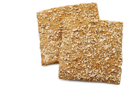 spelled: crispy cracker spelled with crushed wheat kernels on a white background