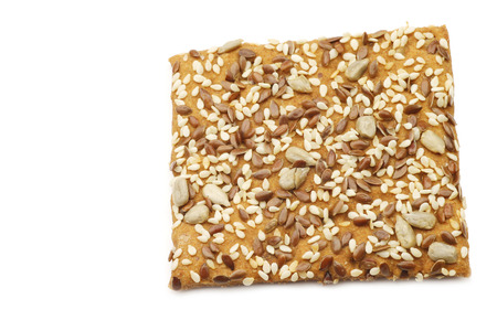 spelled: crispy cracker spelled with mixed seeds on a white background Stock Photo