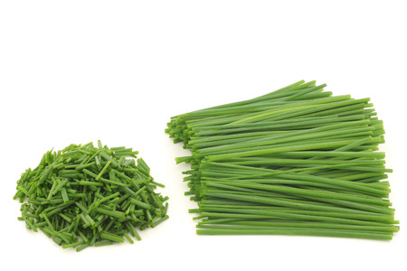chive: Bunch of freshly cut green chive on white background