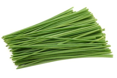 layman: Bunch of freshly cut green chive on white background