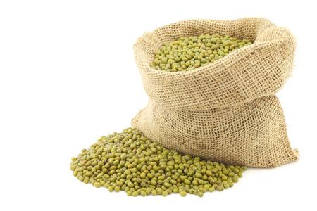 vigna: Mungo beans Vigna radiata in a burlap bag on a white background