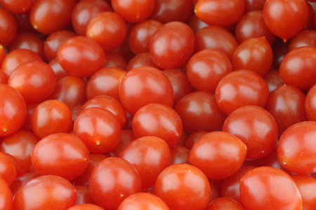 plant antioxidants: fresh Tomberry very small tomatoes background Stock Photo