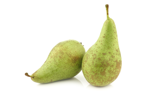 two fresh pears conference on a white background