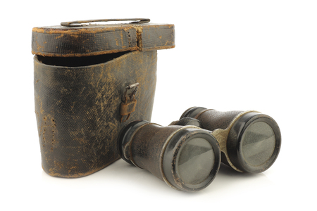 antique binoculars: old binoculars with a case on white background Stock Photo