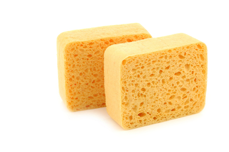 domestication: yellow household sponges on a white background
