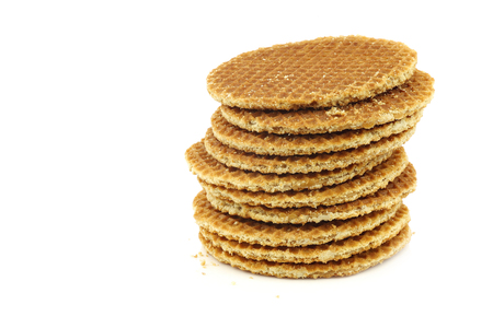 treacle: stacked Dutch waffle called a syrup on a white background Stock Photo