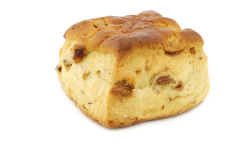 scone: traditional english scone with raisins on a white background Stock Photo