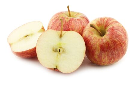 small fresh sweet apples and a cut one on a white background Stock Photo