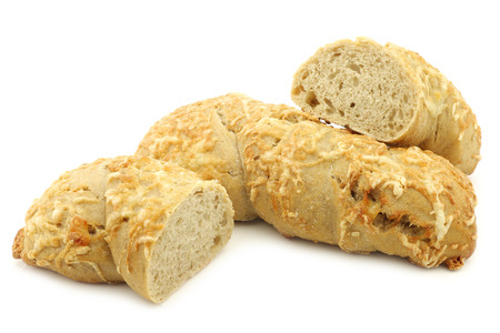 spelled: freshly baked spelled bread covered with grated cheese and a cut one