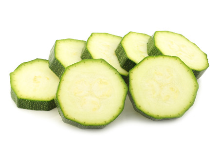 nutriment: zucchini slices on a white background