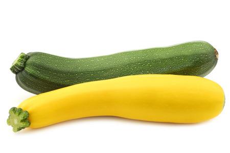 yellow green: green and yellow zucchini (Cucurbita pepo) on a white background