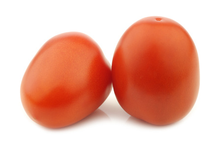 peer to peer: fresh and colorful italian roma tomatoes on a white background