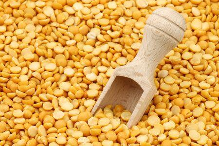 pea: yellow split peas with wooden scoop background