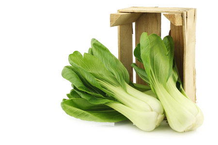 bok choy: Shanghai fresh (small) bok choy in a wooden crate on a white background Stock Photo