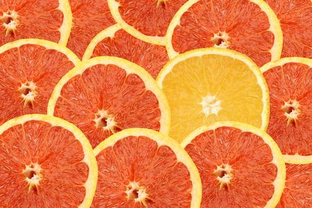Rote und gelbe Orangen Hintergrund Standard-Bild