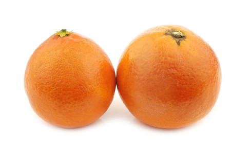 two fresh blood oranges on a white background