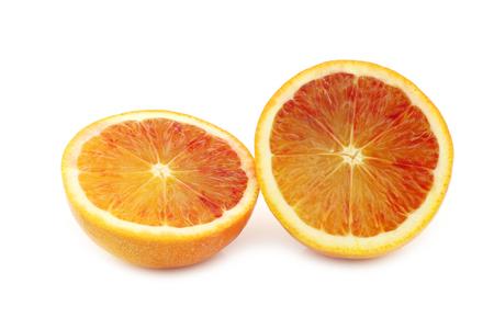 two fresh blood orange halves on a white background