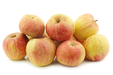 bunch of cooking apples on a white background