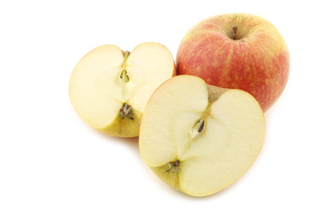 fresh Dutch apple and a cut one on a white background 版權商用圖片