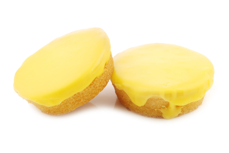Traditional Dutch yellow glazed cakes on a white background