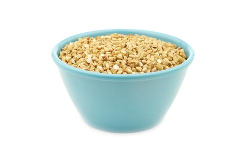 Organic organic buckwheat in a blue bowl on a white background