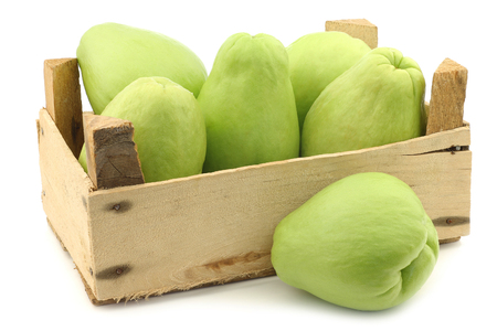Chayote fruit (Sechium edulis) and a cut on a white background 版權商用圖片