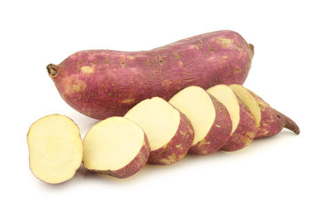 Freshly harvested sweet potato and some slices on a white background 版權商用圖片