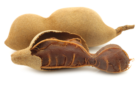 tamarind beans and an opened one on a white background