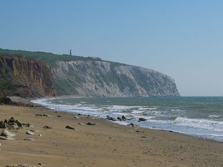cliff face: Seascape from Sandown (Isle of Wight) beach, of the sea, sand, rocks and the Culver cliff face. Stock Photo