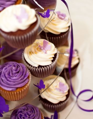 Wedding Cake -Closeup on Beautiful Yummy Blueberry and Chocolate Cupcakes photo