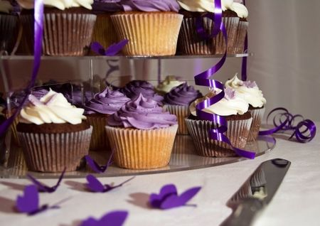 butterfly knife: Wedding Cake - Bunch of Yummy Traditional Colorful Chocolate Cupcakes on a table with a Knife