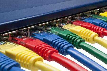 Multi colored ethernet network cables connected to a router / switch isolated on white background Stock Photo - 7258361