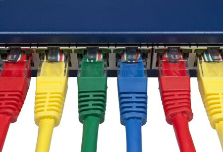 network cables: Top view of rainbow colored ethernet network cables connected to a router isolated on white background