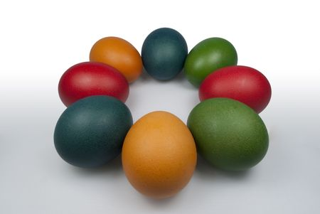 Group of Coloured Easter Eggs on the white background. Circle of Eggs photo