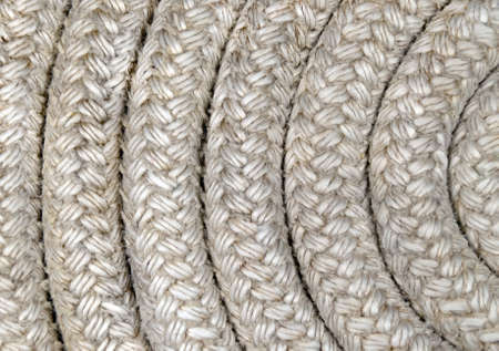 Old nautical rope - Closeup Detail on a reel of twisted boat's rope Stock Photo - 8376103