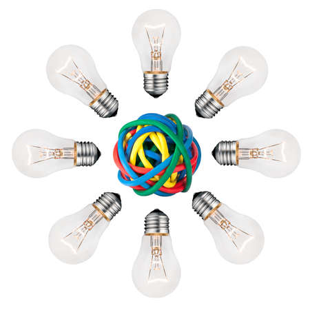 Bright New Ideas Abstract - Lightbulbs in a circle around a ball of colored cables isolated on white background photo