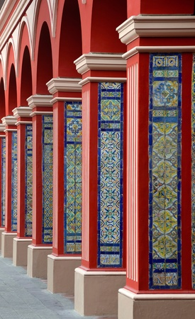 Red Arch Columns Pathway with Classic Colorful tiles - Lima Peru photo