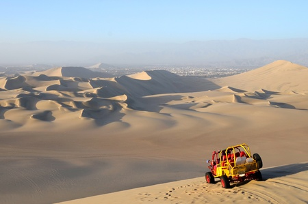 View of Sand Dessert with Dune Buggy in foreground