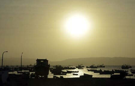 Bay Full of Fishing boats Silhouettes with Setting Sun Stock Photo - 10795750