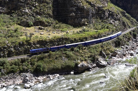 cuzco: Train going to Machu Picchu from Cuzco in  the valley with Urubamba river