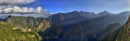 HDR Panorama of Sunrise over the Ruins Machu Picchu - Sacred city of the Incas photo