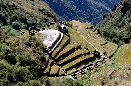 archaeology: View of Phuyupatamarca ruin on the Inca Trail to the ruins of Machu Picchu with Amazon Jungle